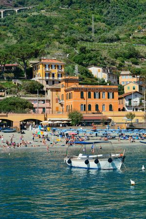 MONTEROSSO - MAY 22: People enjoy beach on May 22, 2016 in Cinque Terre, Italy. Monterosso is one of the five villages in Cinque Terre. It is a major tourism attraction and UNESCO World Heritage Site