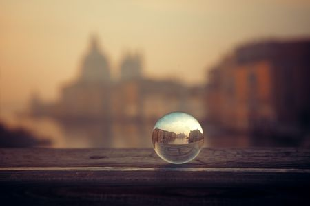 Crystal ball view Venice Church Santa Maria della Salute and canal in Italy. Stok Fotoğraf