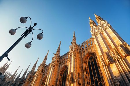 Duomo and lamp post at Cathedral Square or Piazza del Duomo in Italian, the center of Milan city in Italy. 版權商用圖片