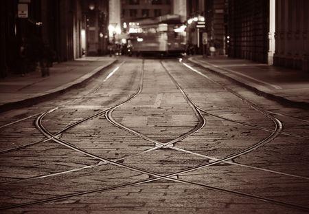 Tram pálya utcai milánói, olasz éjszaka. Stock fotó