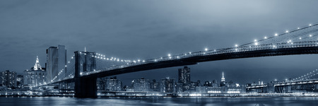 Manhattan Downtown urban view with Brooklyn bridge at night Stock Photo