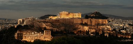 Athens skyline panorama at night viewed from mountain top, Greece.