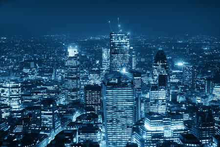 blackwhite: London aerial view panorama at night with urban architectures in black and white.