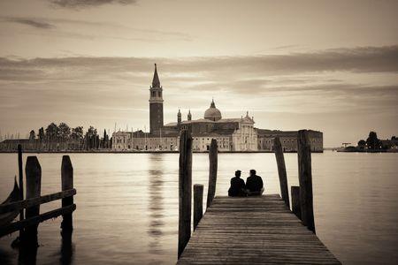 Lovers in front of San Giorgio Maggiore church in Venice, Italy. Stock fotó