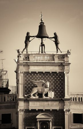 Bell and bronz statue atop of Piazza San Marco in Venice, Italy. Stock Photo