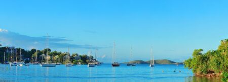 St John bay panorama in the morning with buildings and boats in Virgin Islands.