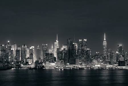 Midtown skyline over Hudson River in New York City with skyscrapers at night 스톡 콘텐츠