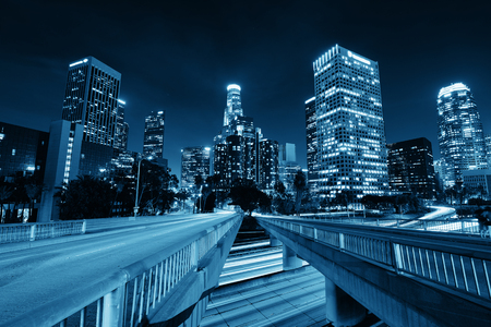 Los Angeles downtown at night with urban buildings and light trail