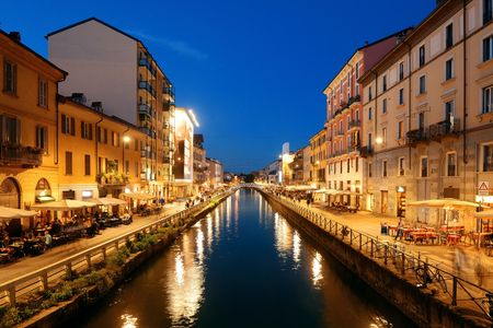 Naviglio Grande canal night life with restaurant and bars in Milan, Italy. Reklamní fotografie