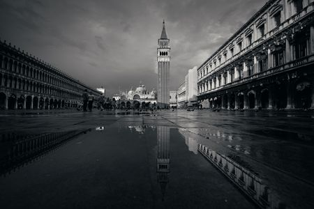 Bell tower and historical buildings reflection at Piazza San Marco in Venice, Italy. Stock Photo