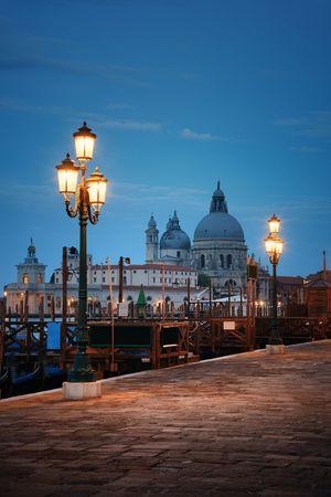 Lamp and  Church Santa Maria della Salute at night in Venice, Italy.