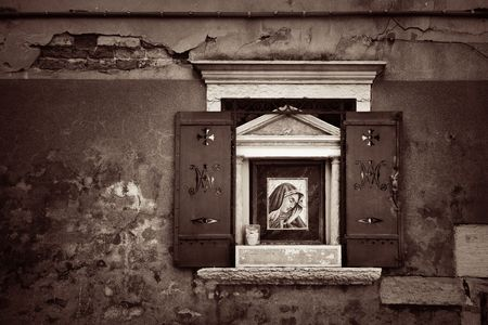 A closeup view of window in historical buildings in Venice, Italy.