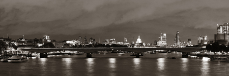 London cityscape at night with urban buildings over Thames River panorama Reklamní fotografie