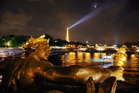 PARIS, FRANCE - MAY 13: Eiffel Tower and Alexandre III Bridge at night on May 13, 2015 in Paris. With the population of 2M, Paris is the capital and most-populous city of France