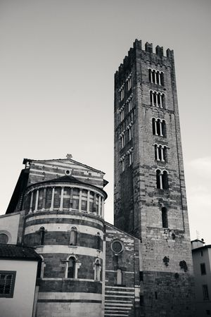 Basilica di San Frediano in Lucca with historic buildings in Italy.