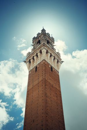 City Hall Bell Tower closeup in Siena Italy.