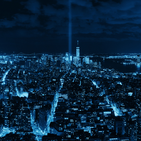 New York City downtown skyline night view and 911 tribute light. Stock Photo