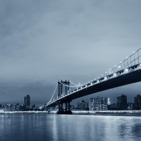 Manhattan Downtown urban view with bridge at night