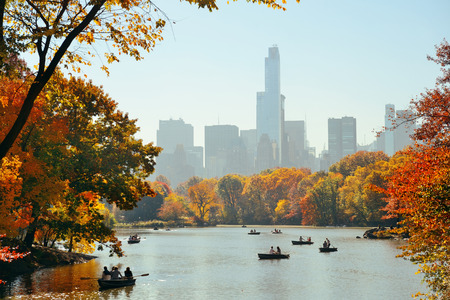 People boating in lake in Central Park in Autumn New York City Stock Photo