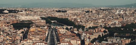 Rome city panorama viewed from top of St. Peter's Basilica in Vatican City.