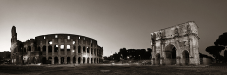 Colosseum and Arch of Constantine at night in Rome Italy black and white
