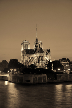 Notre Dame de Paris at dusk over River Seine as the famous city landmark. Stock Photo