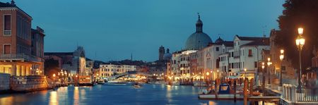 Venice canal view panorama at night with San Simeone Piccolo church and historical buildings. Italy.