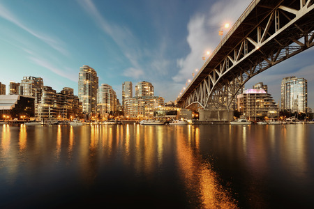 Vancouver False Creek at night with bridge and boat. Reklamní fotografie