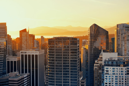 Vancouver rooftop view with urban architectures at sunset.
