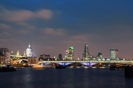 London skyline at night with bridge and St Pauls Cathedral over Thames River. Reklamní fotografie