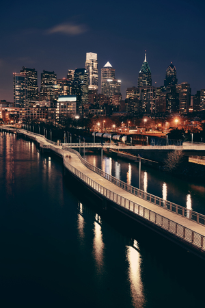 Philadelphia skyline at night with urban architecture.