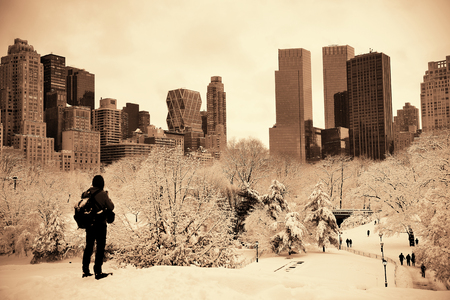 A tourist watching Central Park in midtown Manhattan New York City