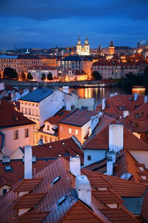 Prague skyline rooftop view with historical buildings at night in Czech Republic.