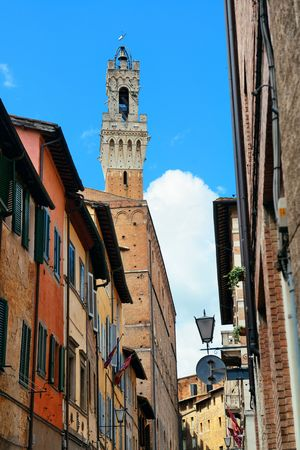 Street view with old buildings and bell tower in Siena, Italy. Banco de Imagens