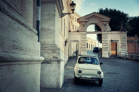 Street view with vintage car in Rome, Italy.