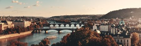 Prague skyline and bridge over river in Czech Republic panorama.