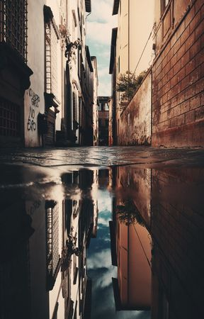 Lucca street view with water reflection after rain in Italy