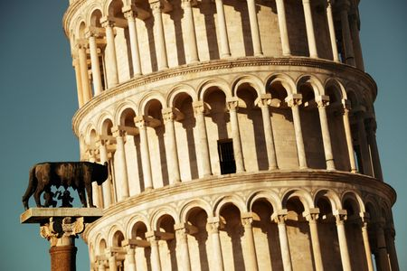 Leaning tower with Capitoline Wolf (or she-wolf) sculpture in Pisa, Italy as the worldwide known landmark. Stock Photo