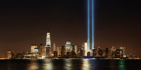 New York City downtown skyline at night panorama over Hudson River and September 11 tribute light Stockfoto