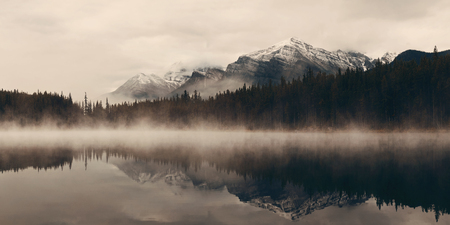 Lake Herbert panorama in a foggy morning with glaciers mountain and reflection in Banff National Park, Canada Banco de Imagens - 112817939