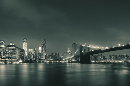 Manhattan Downtown urban view with Brooklyn bridge at night Фото со стока