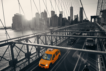 Brooklyn Bridge with traffic in downtown Manhattan New York City