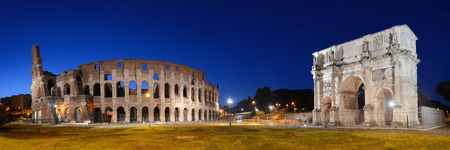 Colosseum and Arch of Constantine at night in Rome Italy
