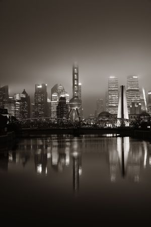 Shanghai city night view with skyscrapers and water reflections in China. 스톡 콘텐츠