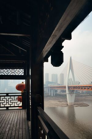 Hongyadong complex with bridge and city urban architecture in Chongqing, China. 스톡 콘텐츠