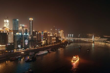 Aerial view of urban buildings boat and city skyline at night in Chongqing 스톡 콘텐츠