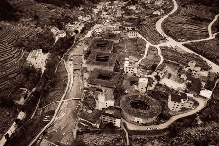Aerial view of Tulou, the unique dwellings of Hakka in Fujian, China. Stock Photo