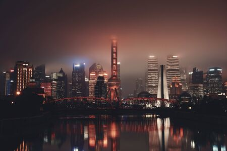 Shanghai city night view with skyscrapers and water reflections in China. Stok Fotoğraf