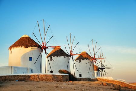 Windmill at sunset as the famous landmark in Mykonos Island, Greece. Stok Fotoğraf