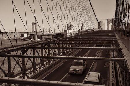Brooklyn Bridge with traffic in downtown Manhattan New York City 写真素材 - 129570553